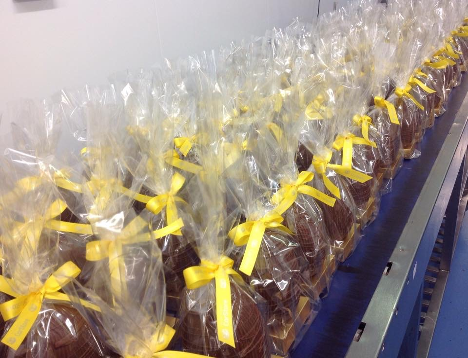 Easter Eggs on simple gold plinth packed into a clear bag and hand finished with ribbon bows.
